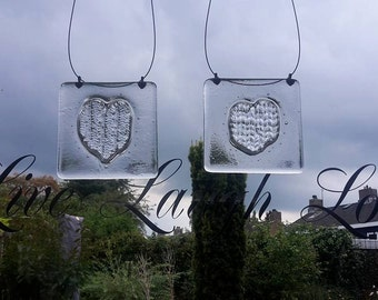 Knitted heart in glass