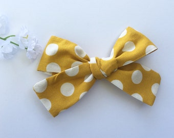 Mustard polka dot hair bow