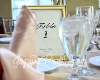 Gold framed wedding table numbers