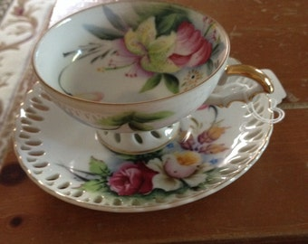 Beautiful pink flowered tea cup and saucer