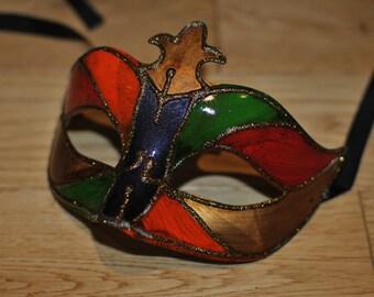 Venetian styled Masquerade Harlequin mask.Multicoloured. Gold glitter finish.