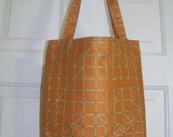 Tote bag in geometric tangerine with teal and white accents
