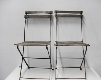Couple garden in iron and wood chairs