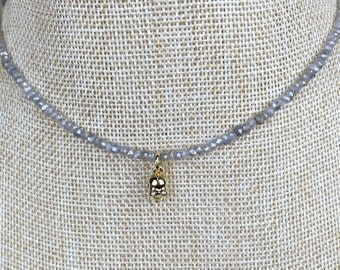 Choker of mystic labradorite with a dainty gold skull charm.