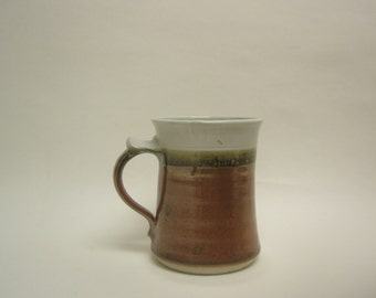 Wheel thrown Stoneware mug. Iron red and Buttermilk glazed