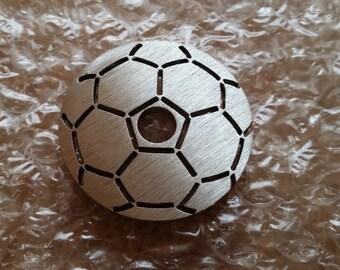 Football shaped 45 rpm adaptor