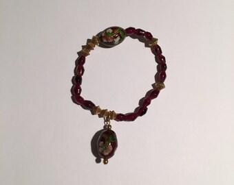 Beaded garnet and gold filled beads bracelet