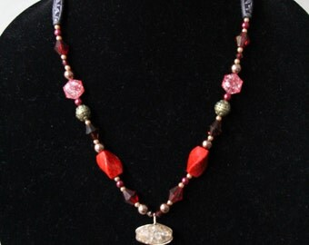 Plastic Bead Necklace With Wire-Wrapped Heart Pendant