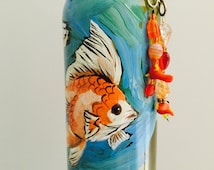 Wind chime,wine bottle,gold fish,seashells