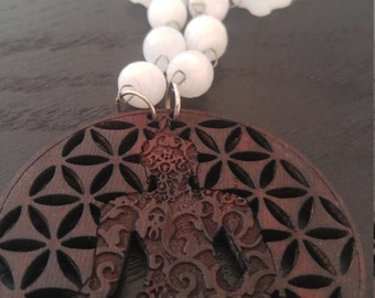 White agate necklace with carved cedar wood pendant