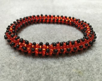 Ladybird spots red and black bangle