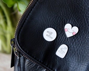 Pin tiptych: kind hugs, still alive & blushing heart.