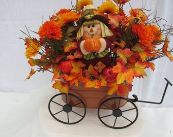 Little scarecrow doll in a wagon:  Fall-autumn-Halloween-Thanksgiving; faux-silk-artificial flowers; leaves;pumpkins and squash; scarecrow