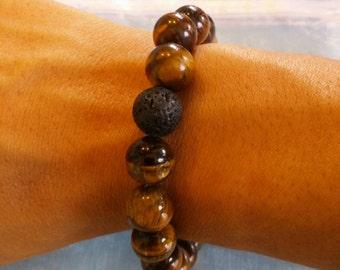 Tiger eye stone bracelet with one lava stone.