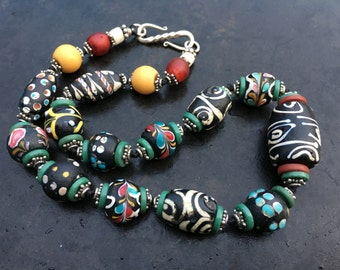 Choker of antique Venetian fancy wound trade beads and Bali silver