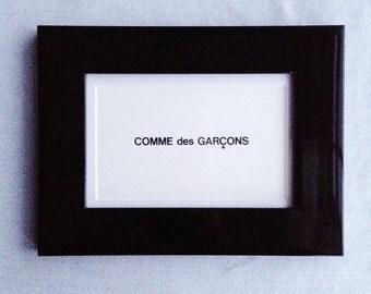 A Framed Comme des Garcons Print