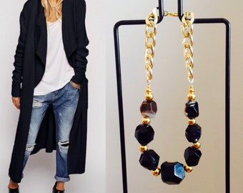 Black tourmaline and golden chain necklace