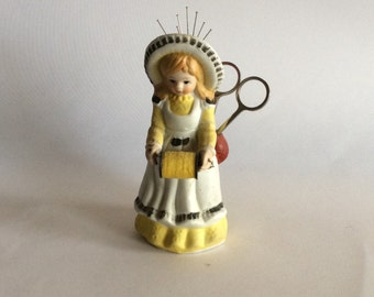 Porcelain seamstress, pin, thread and scissor holder, figurine, girl in yellow and white