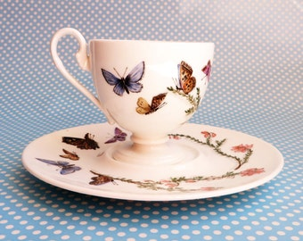 One of a kind hand painted dainty bone china cup and saucer signed AL
