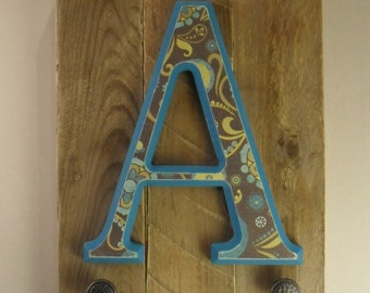 Initial on wood plaque with hooks – A