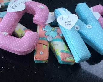 Paper mache, padded, fabric letters