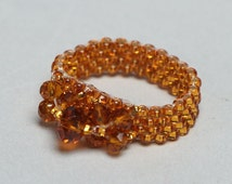 Handmade beaded ring with crystal