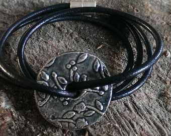 Leather bracelet with black raku ornament