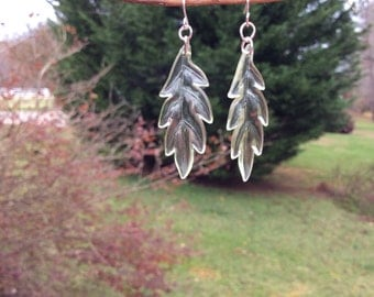Clear-ish light green leaf earrings