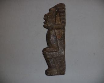 Mexican sculptured quartzite sitting man statue