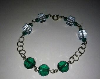 Beaded Bracelet with swavorski emerald crystal beads, and aquamarine plastic beads