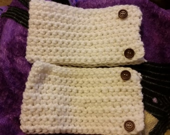 White Boot cuffs with brown buttons