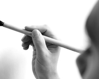 Black and White Photograph of Artist and Brush