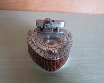 An unusual table cigarette lighter