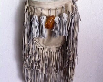 Real handmade crossbody bag from soft leather with elements of fashionable leather fringe with amber new women's beige color bag size-small.