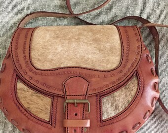 Leather messenger bag. One piece.