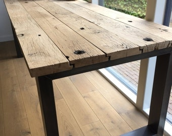 Old oak table with steel base