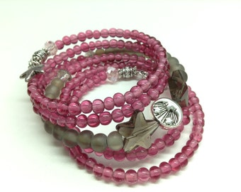 Pink and gray multi-stranded bracelet on memory wire