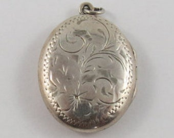 Vintage Sterling Silver Oval Locket With Floral Motif On The Front & Engraved A