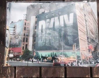 DKNY Full Colour Advertising Photograph (Depicts Manhattan and Twin Towers)