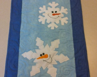 Snowflake quilted wall hanging
