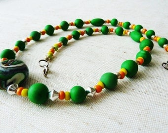 Modern polymer clay necklace rockery, green glass beads yellow orange and silver
