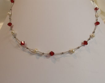 Beaded necklace white freshwater pearls and Red Swarovski Crystal