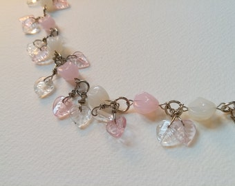 Glass beads necklace, a combination of pink and white flower buds & leaves shape beads