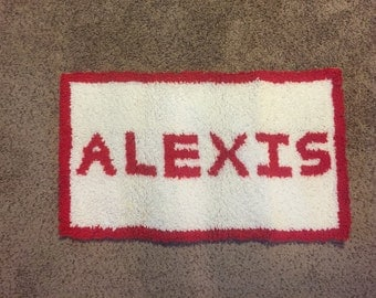 Hand hooked Rug of name ALEXIS.
