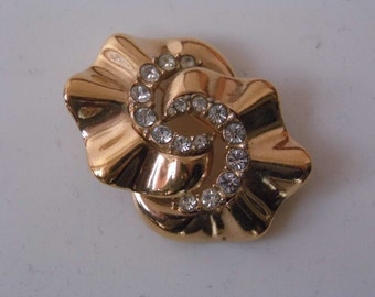 1980s gold tone brooch by CINER