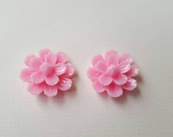 2 large pink cabochon flowers