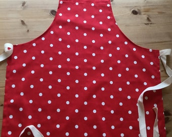 Red apron with white polka dots