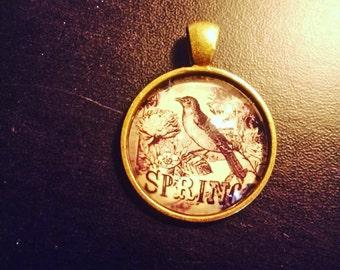 Locket and chain in bronze, 'bird' pattern