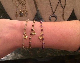 Rosary bracelet with shark tooth charm
