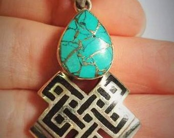 Beautiful Tibetan pendant with the endless knot and decorated with pieces of Turquoise.